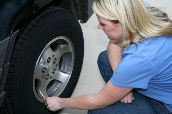 woman-checking-air-pressure-in-tires boise meridian garden city eagle Idaho oil changes